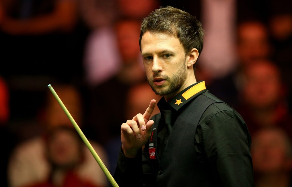 Judd Trump of England plays a shot during his first round match against Stephen Maguire of Scotland on day Two of the 2015 Dafabet Masters at Alexandra Palace on January 12, 2015 in London, England.